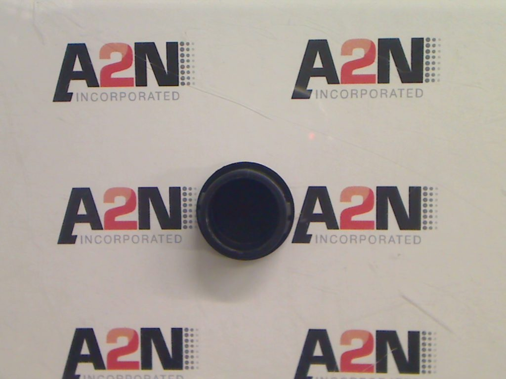 A larger rigid plastic locking plug
